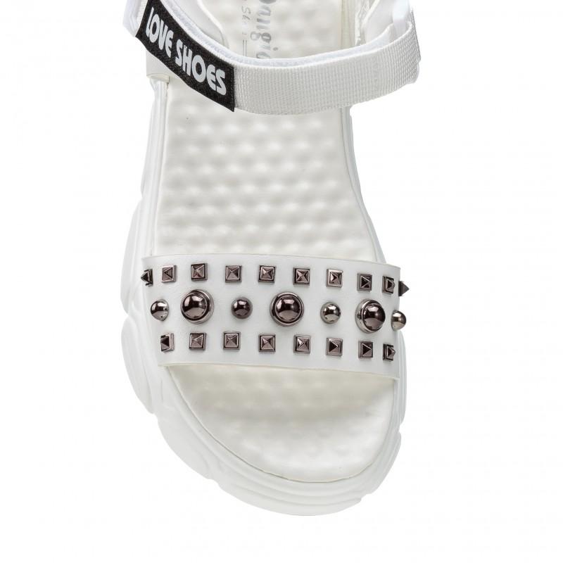 Босоніжки жіночі білі спортивні шкіряні на тракторній підошві Pino dangio