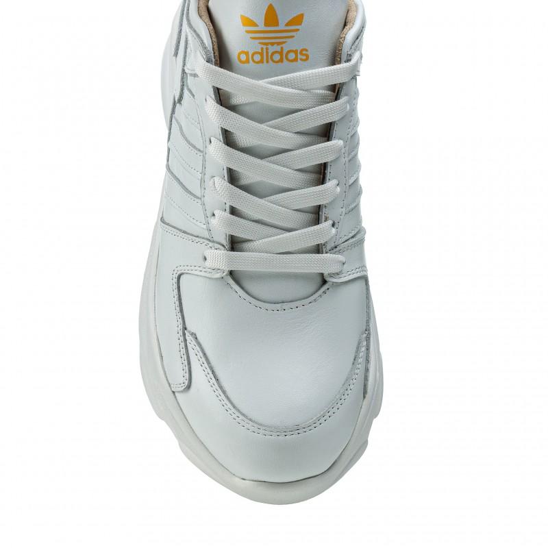 Кросівки жіночі шкіряні білі на високій підошві